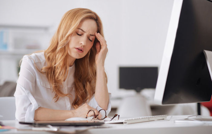 tired woman sitting at a desk
